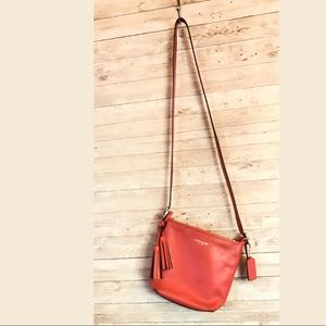 Coral mini legacy Coach crossbody bucket purse